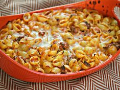 Baked Shells with Roasted Red Pepper Cream Sauce and Italian Sausage.   A base of roasted red pepper cream sauce swaths pre-cooked, medium-sized pasta shells. I like the sauce smooth and silky, so I purée the roasted pepper mixture before adding a combination of heavy cream and half-and-half, along with three cheeses: ricotta, Fontina, and Asiago. Italian sausage, garlic, and onions, boost the sauce with extra flavor.