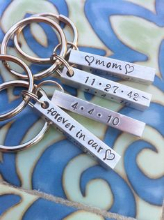 Personalized 4 sided hand stamped aluminum key chain. $14.00, via Etsy.