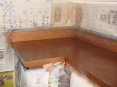 DIY aged copper countertop with 3d imprint on backsplash using spray paint