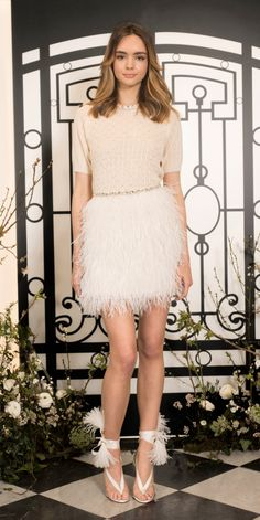 Jenny Packham short dress for wedding mini skirt with short sleeves and feather skirt  | Pin discovered by Kelly's Closet bridal boutique in Atlanta Georgia