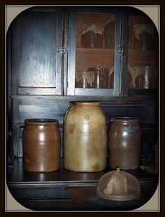 Crocks in old blue cupboard