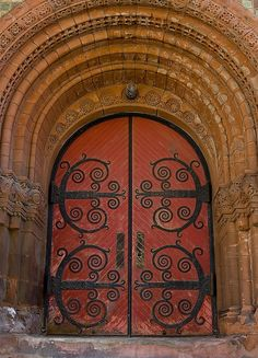 red doors with wrought iron