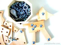 "screws, bolts, nuts, wood- what a great idea for boys!  Pinner said ""This would be With my scrollsaw, I always end up with little pieces of timber. So I just drilled some holes and bought lots of bolts and nuts for the children to have an easy construction game:"""