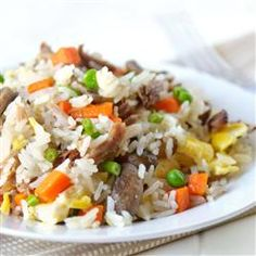 """Pork Fried Rice   """"This is a quick and easy way to enjoy stir-fried rice with pork and vegetables at home."""""""