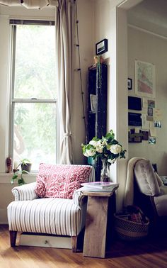 via Design Sponge #living #room #art #gallery #wall #leather #chair #window