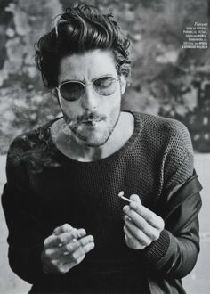 Louis Garrel smoking a cigarette (or weed)