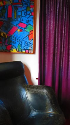 Karuselli chair and vibrant painting