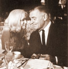 Marilyn Monroe and Clark Gable at a party for The Misfits