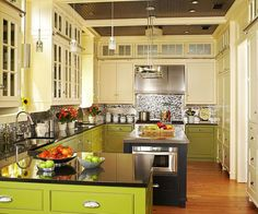 Butter + Citron + Black:  I love the vibrancy of this kitchen...the two colors of the cabinets paired with the black/gray is beautiful.  I also love that it is not a tremendous kitchen; big always isn't better. What a fabulous kitchen!!!