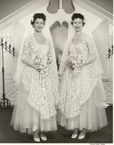 The twin daughters of Mr. and Mrs. C.A. Green, Marlene and Darlene Green, were married in a joint wedding ceremony at the Little Church on the Prairie on August 11, 1954, their birthday. The two brides posed side-by-side in identical wedding gowns in front of the church altar. They appear to be carrying Stephanotis bouquets and they have matching pearl necklaces. Marlene Green married Claude Flansburg while Darlene wed William Melville.