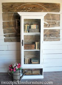 Sweet Pickins gun cabinet transformation.  Love the change.  With chicken wire instead of glass it would be great in the kitchen to house baskets of fruit and veggies.