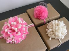 Project #3 from @Brett Bara: Pom-Pom Gift Bows: This project uses yarn pom-poms as a stand in for traditional gift bows. The poms are super easy to make by wrapping the yarn around your own hands (no special pom-pom making tools are required), and they're a great use for leftover yarn.     #crafts #holiday #pinspirationparty