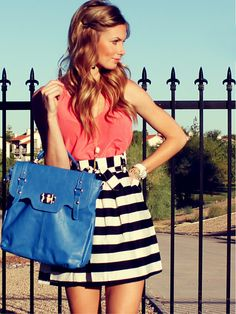 Mix coral tones with black and white stripe skirt