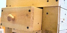 How To Make A Rustic Pallet Cabinet ; between the washer & dryer