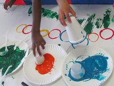 """The Very Hungry Caterpillar"" -cup circles, forks dipped in paint for grass"