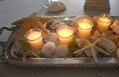 Silver, sand, shells and candlelight