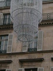 a gigantic chandelier in the middle of a street in Paris...but of course....