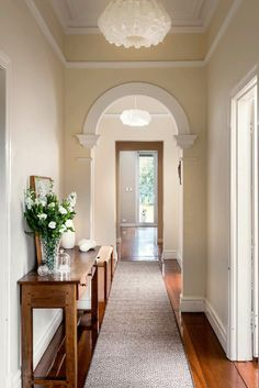 Elegant hallway styled by Collected Interiors featuring a custom Armadillo&Co Masai weave rug