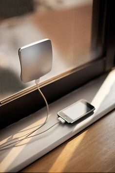 Solar window charger with built in battery.