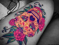 Colorful sugar skull leg tattoo.