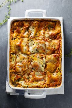 Skinny Spinach Lasagna - layers of ricotta, spinach, noodles, sauce and cheese.