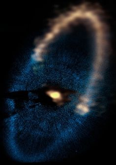 The narrow dust ring around Fomalhaut. Yellow at top is the ALMA image, and the blue at bottom is Hubble Space Telescope image. The star is at the location of the bright emission at the center of the ring.