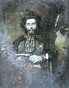 """William """"Bloody Bill"""" Anderson's body photographed and on display for public viewing hours after his death in Richmond, Missouri by Colonel Cox and his Union forces. Anderson, noted Southern Guerrilla leader often riding with Quantrill, his body was found with a string that had 53 knots - symbolizing each person he had killed."""