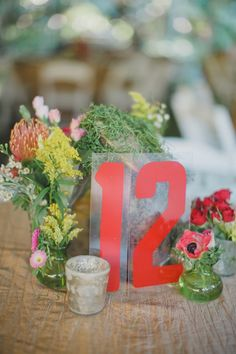 gas station number cards as table numbers, photo from By the Robinsons http://ruffledblog.com/sunken-gardens-florida-wedding #tablenumbers #red #weddingideas