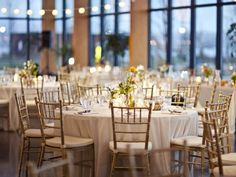 gold chairs and taupe linens - Charming Rustic Wedding Reception