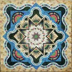 Glacier Star designed by Quiltworx.com, made by Sylvia Bryan, and quilted by Debbie Tribble.  Took 2nd place at the fair.