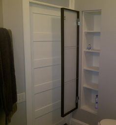 Bathroom storage between the studs with a recessed shelf