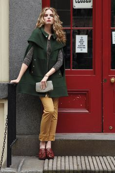green cape with mustard pants.
