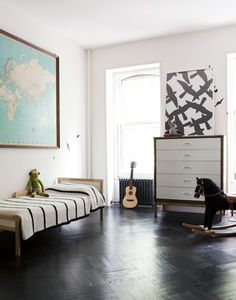 Love the black and white with the pop of aqua in the map. Great neutral kids' room.#rhbabyandchild #fallinlove
