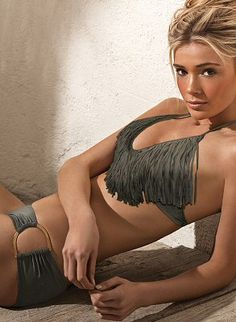 Taupe halter top with flattering fringe detail which elongates torso.  Low-rise taupe hipster bottom with exaggerated gold D ring detail at hips by L Space Swimwear, $157.00