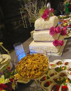 Wedding dessert display with embossed wedding cake by Culinary Creations