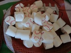 Baseball marshmallows!  Food coloring with toothpick. Perfect for holiday bonfires!