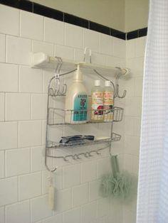 hang shower caddy on towel bar using closet hooks.