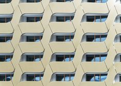 Detail shot of a hotel's gold-coloured steel facade.
