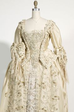 Elizabeth Swann's wedding gown from Pirates of the Caribbean: Dead Man's Chest. You can't tell much in the movie, so when I found these pictures, I thought it was lovely :)