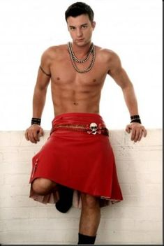 Hunky dude wearing a bright red kilt