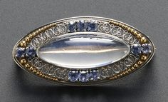 A TIFFANY 1915,s montana sapphire and moonstone brooch