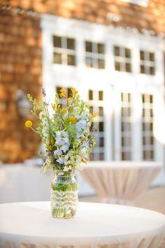 simple table decor with mason jar centerpiece #centerpiece #masonjar #weddingchicks http://www.weddingchicks.com/2014/01/22/classy-country-wedding/