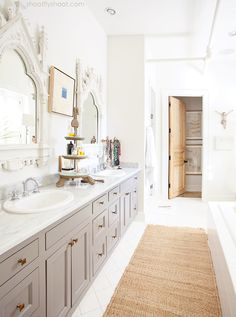 gray cabinets, brass knobs, white marble