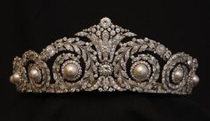 Good clear image of tiara of Queen Victoria Eugenia, born a princess of Battenberg. One of the many grandchildren of Queen Victoria, she married King Alfonso XIII of Spain in 1906. The tiara went to her daughter, Infanta Maria Cristina, Countess of Marone. And then it ended up back in the main royal line (some say it was purchased by and some say it was given to or inherited by King Juan Carlos), and is now worn by Queen Sofia. See also Pearls I