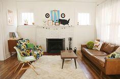 Love the midcentury pieces and overall feel of Katie's living room. Skunkboy Home by Skunkboy Creatures., via Flickr