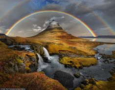 Awe-inspiring: A spectacular rainbow curves over Kirkjufell, in Iceland, snapped by photog...