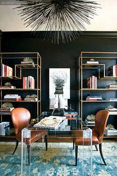 Dark walls and gold shelves