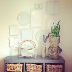 White plates on white walls