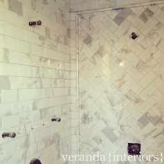 honed Calcutta gold marble counters, so to compliment that I went with a Calcutta gold 3x6 tile for the shower. Keeping up with the herringbone pattern I have in a few areas in the home I had the tile setter incorporate it into this space.