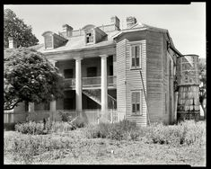 "St. John the Baptist Parish, Louisiana, 1938. ""Evergreen Plantation -- Wallace vicinity. Structure dates from 1835. Abandoned."" The house is now fully restored and open for tours."